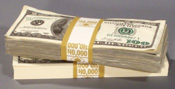 used and new prop money stacks