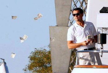 Leonardo DiCaprio throwing prop bills from a yacht